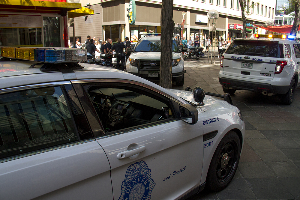 Police presence on the 16th Street Mall has been ratcheted up in recent weeks after several violent incidents in the area went viral. (Kevin J. Beaty/Denverite)  16th street mall; sixteenth street; cbd; central business district; denver; denverite; kevinjbeaty; colorado; police;