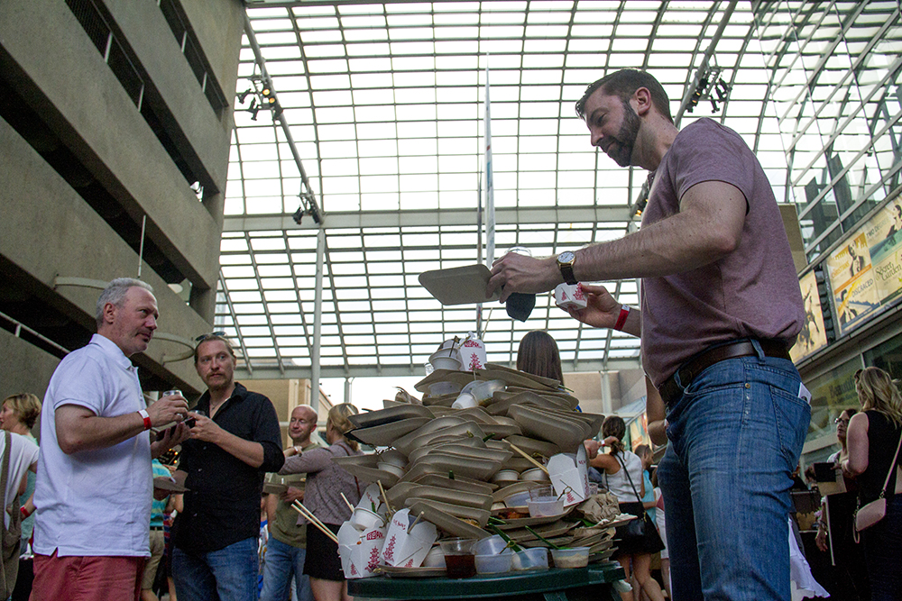 Diners play the treacherous game of garbage Jenga at the Big Eat. It did not end well. Denver Center For The Performing Arts, July 14, 2016. (Kevin J. Beaty/Denverite)  food; big eat; Denver Center For The Performing Arts; denver; kevinjbeaty; colorado; denverite;