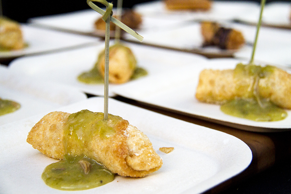 """Mini chile rellenos topped with La Loma's """"famous"""" green chili, prepared for the Big Eat at the Denver Center For The Performing Arts, July 14, 2016. (Kevin J. Beaty/Denverite)  food; big eat; Denver Center For The Performing Arts; denver; kevinjbeaty; colorado; denverite;"""