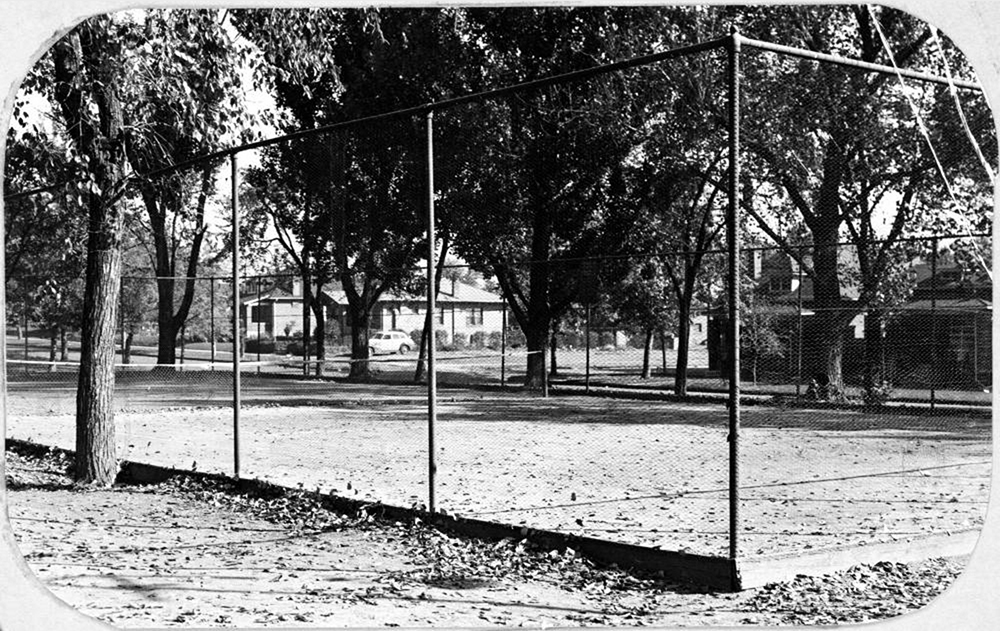 """""""Tennis court Columbus Park 38th & Osage""""  """"View of the tennis court in Columbus Park at 38th (Thirty-eighth) Avenue and Osage Street in Denver, Colorado.""""  Between 1930 and 1940. (Denver Public Library/Western History Collection/X-20330)"""