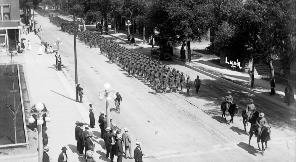 Cavalry soldiers lead Army troops on a Colorado Day march through Denver in 1917, a decade after the celebration was inaugurated. (George L. Beam/Denver Public Library/Western History Collection/GB-7577)