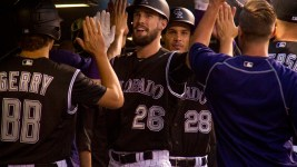 David Dahl high fives teammates after a home run hit. Colorado Rockies vs L.A. Dodgers. August 4, 2016. (Kevin J. Beaty/Denverite)  colorado rockies; los angeles dodgers; baseball; sports; kevinjbeaty; coors field; denver; denverite; colorado;