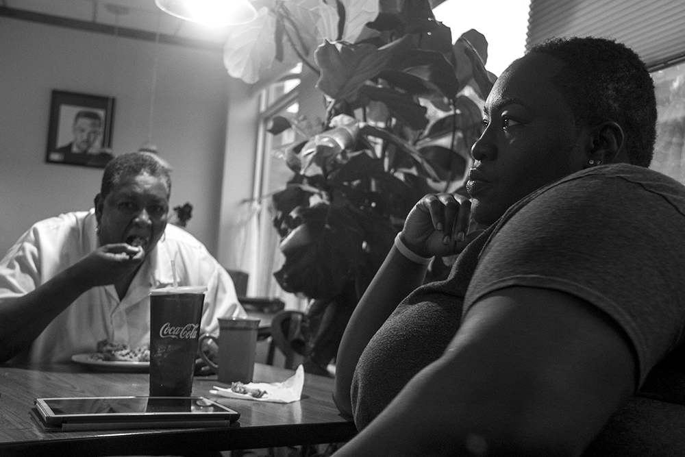 Welton Street Cafe owners Fathima Dickerson (right) and her mother Ms. Mona Dickerson in their family restaurant. (Kevin J. Beaty/Denverite)  welton street; five points; development; kevinjbeaty; denver; denverite; colorado;