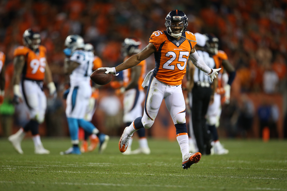 Denver Broncos cornerback Chris Harris Jr. (25) reacts after an interception during fourth quarter action against the Carolina Panthers during the game at Sports Authority Field at Mile High in Denver, CO, September 08, 2016. Photo by Gabriel Christus