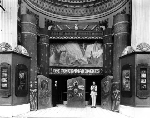 """The Victory Theater with a display of """"Egyptian"""" columns and Moses parting the Red Sea for Cecil B. DeMille's """"The Ten Commandments"""" in 1923. The theater was known for elaborate promotional displays."""