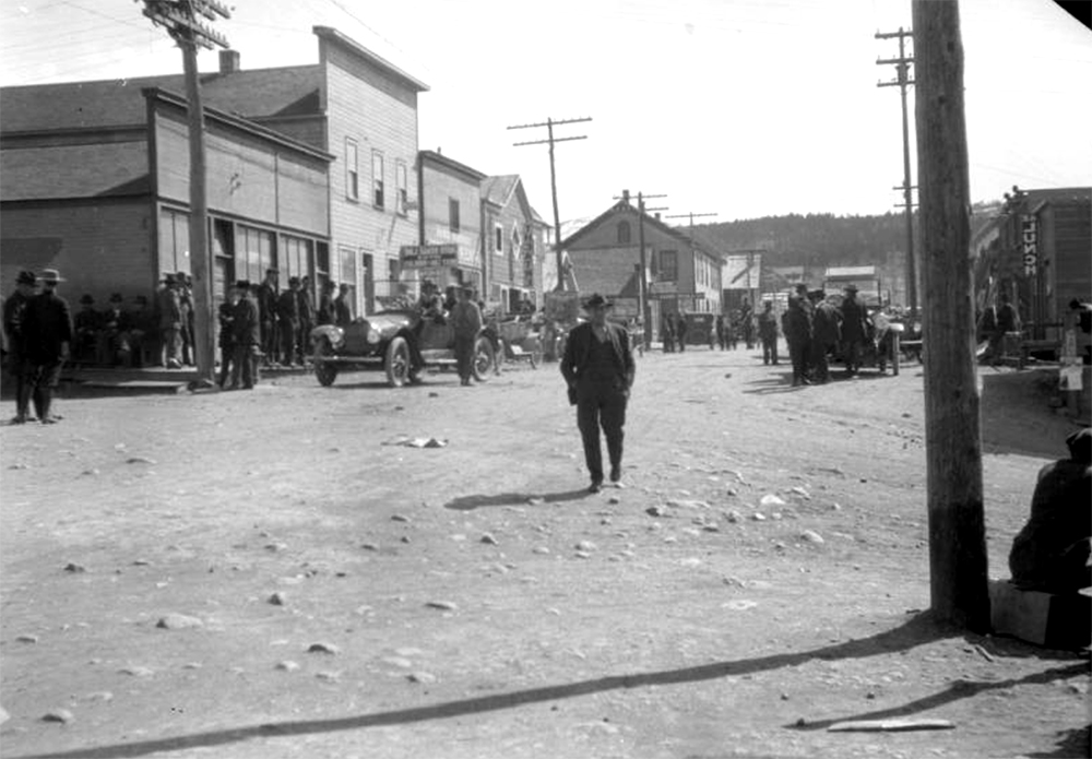 View of Main Street in Nederland (Boulder County), Colorado; shows false front businesses, pedestrians, and cars. Circa 1916. (Donald Kemp/Denver Public Library/Western History Collection/K-80)  five points; historic; denver public library; dpl; archive; archival; denverite