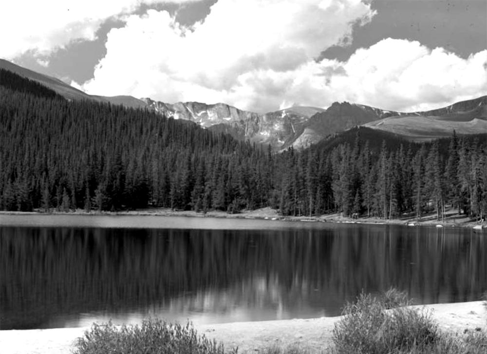 View of Echo Lake near Mount Evans in Clear Creek County, Colorado; pine forest and narrow beaches surround the water. Between 1935 and 1950. (Donald Kemp/Denver Public Library/Western History Collection/K-338)  five points; historic; denver public library; dpl; archive; archival; denverite
