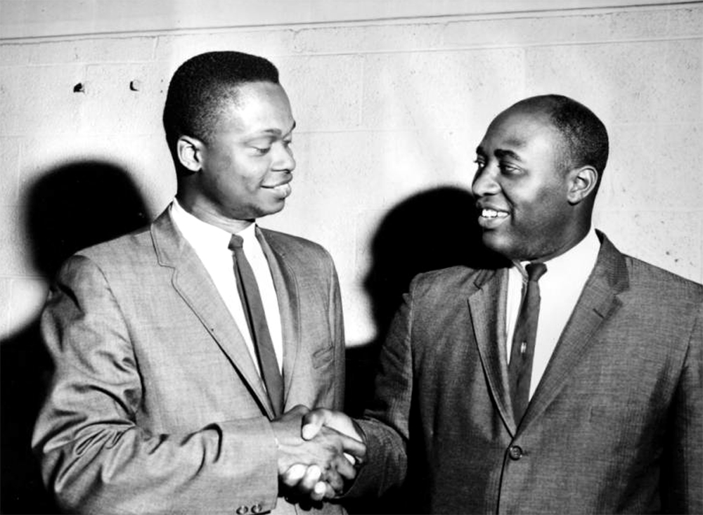 J. Bradley Williams, left, shakes hands with Willie E. Anthony. J. Bradley Williams was the former candidate for Colorado House of Representative for District 15 until he withdrew in favor of Willie E. Anthony on the right. Williams acted as the campaign manager for Anthony. Between 1960 and 1970. (Harry Mellon Rhoads/Denver Public Library/Western History Collection/Rh-5953)  historic; denver public library; dpl; archive; archival; denverite