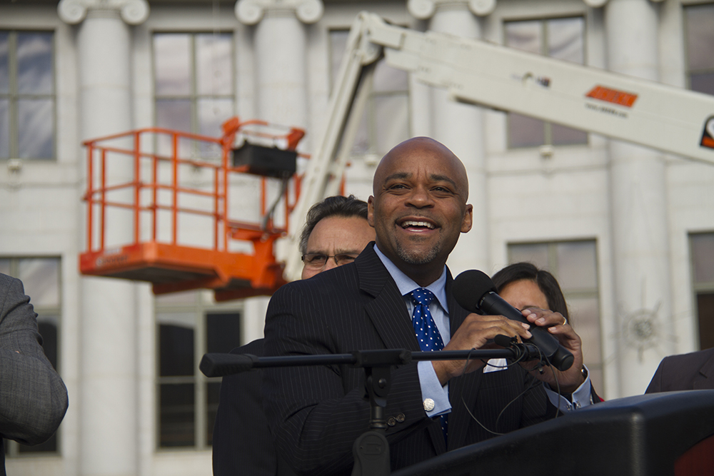 Mayor Michael Hancock speaks to the press at the launch of Denver Day Works. (Kevin J. Beaty/Denverite)  mayor michael hancock; homeless; day labor; social work; kevinjbeaty; denverite; denver; colorado; kevinjbeaty;