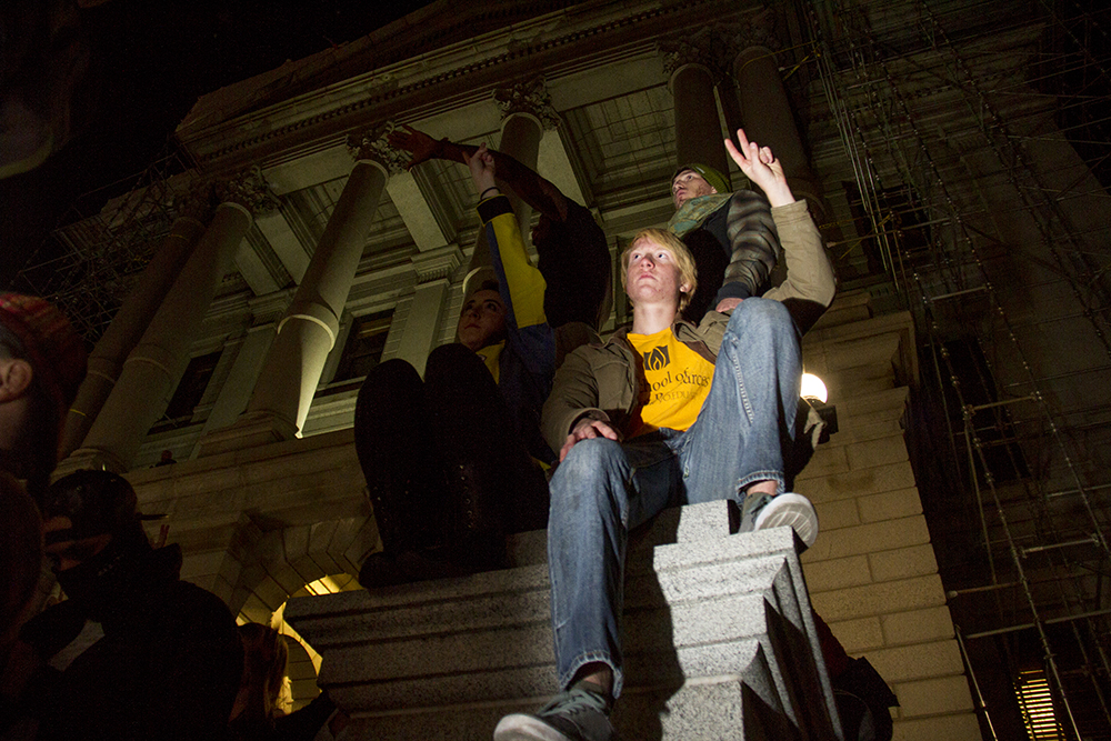 Protesters sit above the Capitol steps after an anti-Trump rally. Nov. 11, 2016. (Kevin J. Beaty/Denverite)  politics; protest; denver; denverite; kevinjbeaty; colorado; trump;