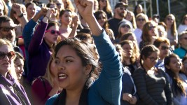 Ana Temeo raises her fist during a rally against Donald Trump in reaction to his election just days prior. Nov. 10, 2016. (Kevin J. Beaty/Denverite)  rally; protest; trump; politics; copolitics; capitol; denver; denverite; colorado; kevinjbeaty; election;