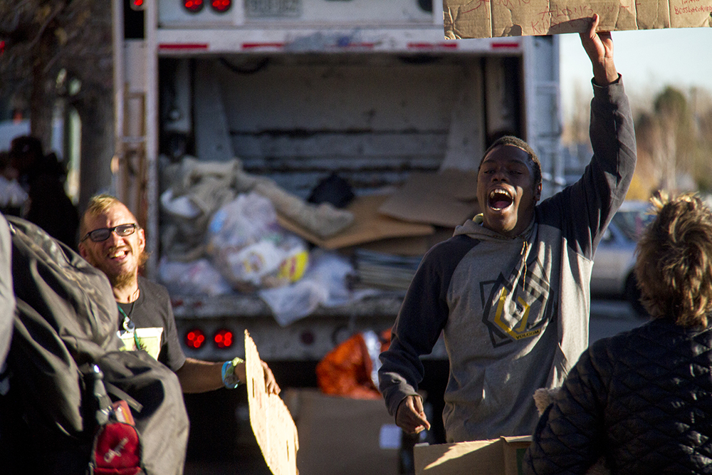"King Reality (right) screams before ""homeless sweeps"" begin on Nov. 15, 2016. (Kevin J. Beaty/Denverite)  homeless; sweeps; denver rescue mission; police; justice; kevinjbeaty; denver; denverite; colorado; camping ban; right to rest;"