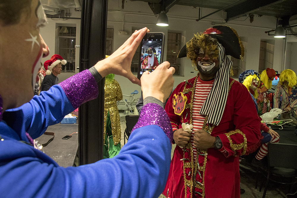 Clown Terrance Carroll in the clown dressing room before the parade of lights. Dec. 2, 2016. (Kevin J. Beaty/Denverite)