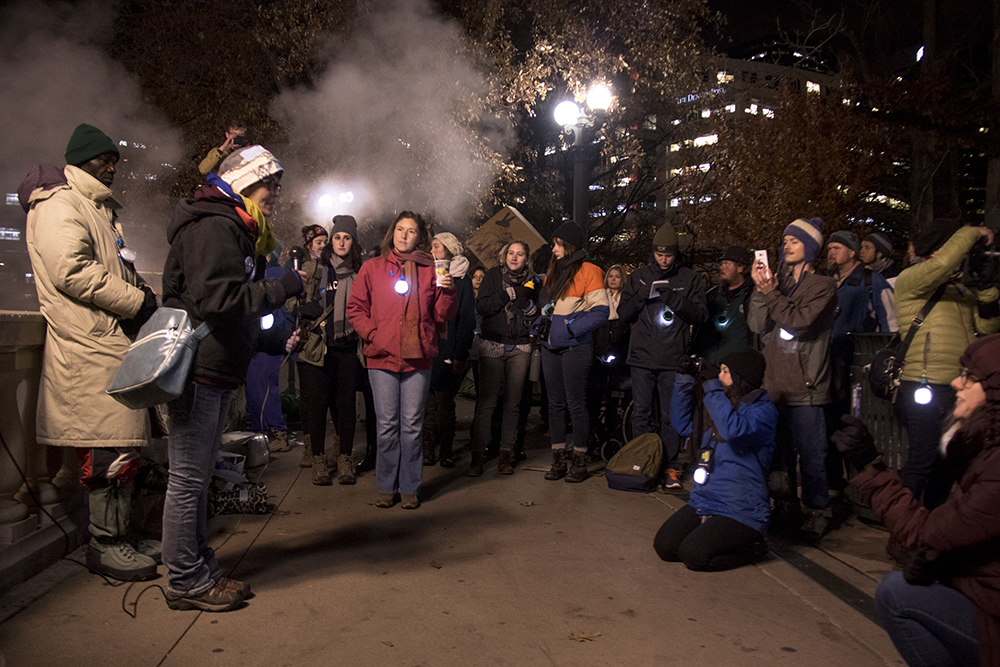 Brandice McMillen speaks at a right to rest protest during the parade of lights. Dec. 2, 2016. (Kevin J. Beaty/Denverite)  camping ban; protest; right to rest; homeless; parade of lights; holiday; christmas; civic center; kevinjbeaty; denver; denverite; colorado;