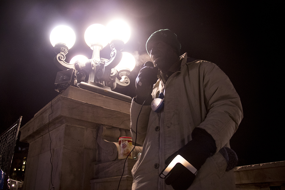 Jerry Burton speaks at a right to rest protest during the parade of lights. Dec. 2, 2016. (Kevin J. Beaty/Denverite)  camping ban; protest; right to rest; homeless; parade of lights; holiday; christmas; civic center; kevinjbeaty; denver; denverite; colorado;