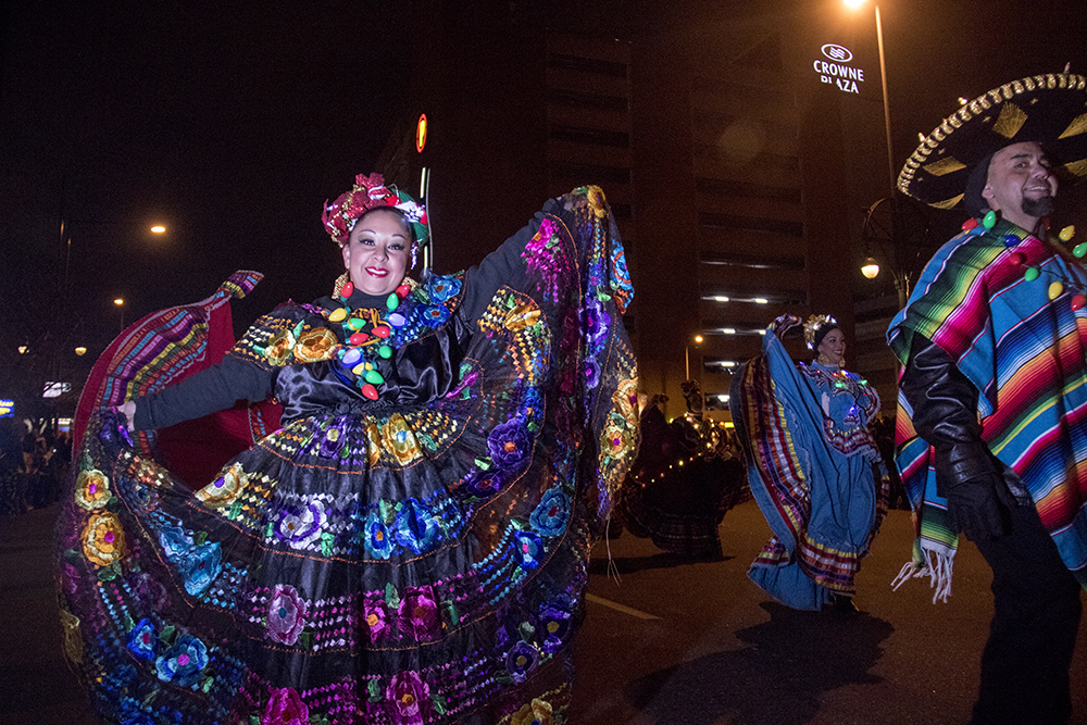 "Dancers twirl to ""Feliz Navidad."" Parade of lights. Dec. 2, 2016. (Kevin J. Beaty/Denverite)