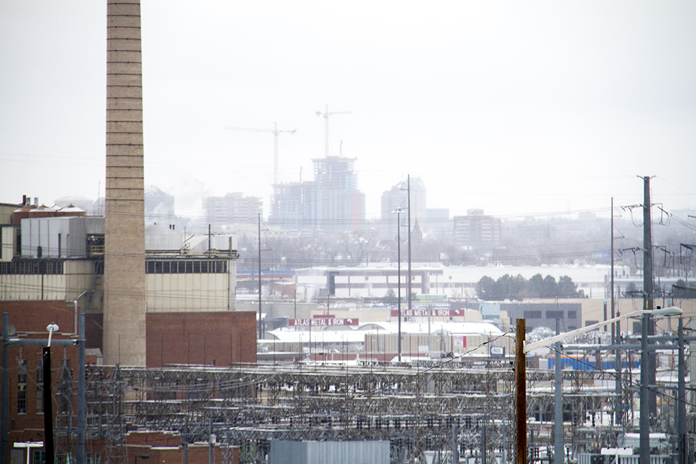 The natural gas-burning Zuni Generation Station and a snowy Denver skyline. (Kevin J. Beaty/Denverite)  skyline; cityscape; cowx; weather; cold; snow; winter; kevinjbeaty; denver; colorado; denverite;