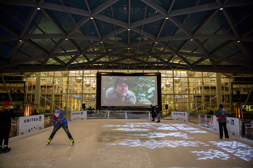 Clark Griswald on screen at Film on the Fly, Dec. 16, 2016. (Photograph provided courtesy of Denver International Airport)  2016; christmas vacation; event; film on the fly; plaza; dia; denver international airport