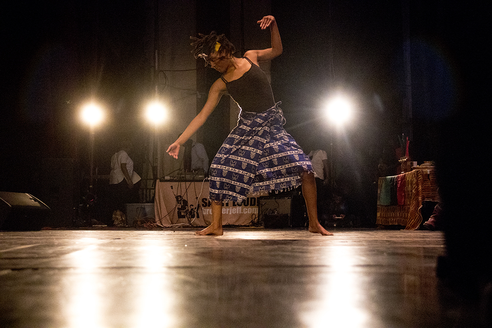 Your Souls Movement's Kalere Hines dances onstage. The first night of Kwanzaa at the Cleo Parker Robinson Dance Theatre, Dec. 26, 2016. (Kevin J. Beaty/Denverite)  kwanzaa; Cleo Parker Robinson Dance Theatre; holidays; denver; denverite; kevinjbeaty; colorado; five points;