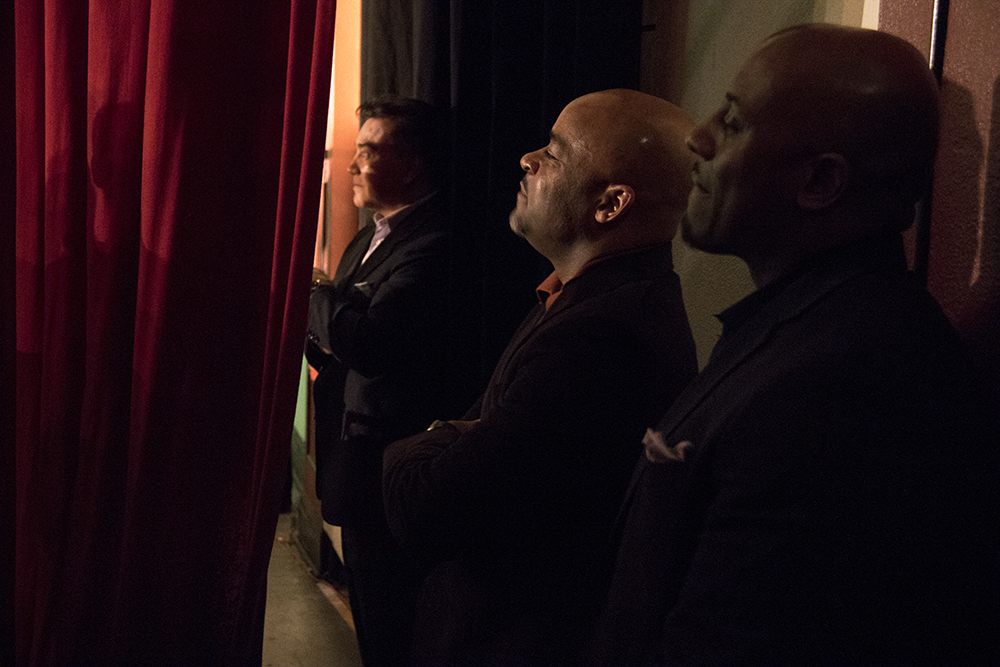 Mayor Michael B. Hancock watches clandestinely from the side of the theatre. The first night of Kwanzaa at the Cleo Parker Robinson Dance Theatre, Dec. 26, 2016. (Kevin J. Beaty/Denverite)kwanzaa; Cleo Parker Robinson Dance Theatre; holidays; denver; denverite; kevinjbeaty; colorado; five points;