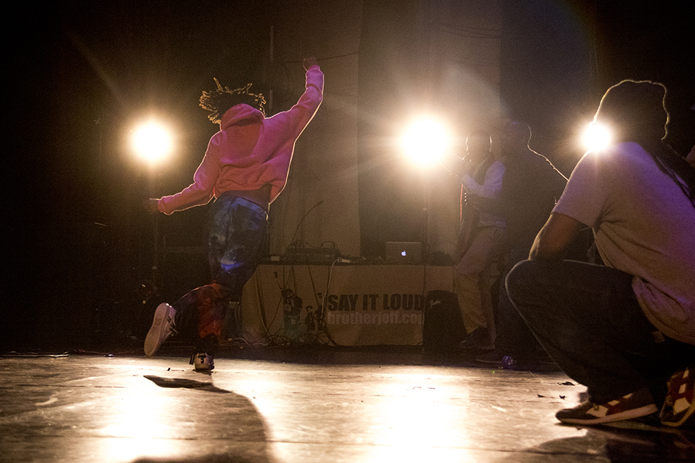 A spinning dancer under spotlights. The first night of Kwanzaa at the Cleo Parker Robinson Dance Theatre, Dec. 26, 2016. (Kevin J. Beaty/Denverite)kwanzaa; Cleo Parker Robinson Dance Theatre; holidays; denver; denverite; kevinjbeaty; colorado; five points;