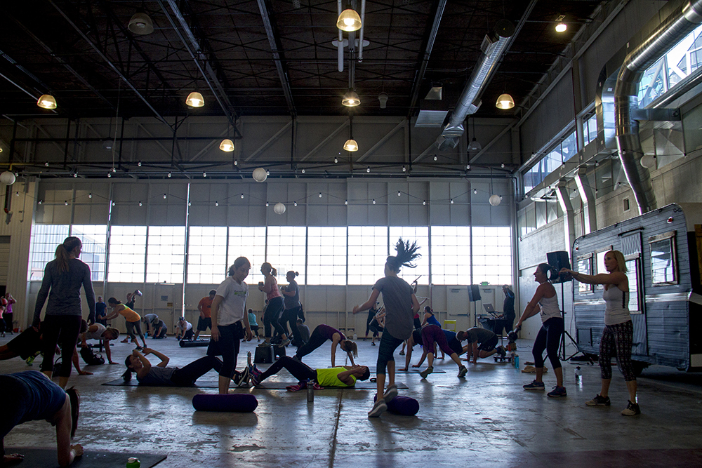 """Endorphin """"boot camp"""" in the hanger at Stanley Marketplace. Jan 7, 2016. (Kevin J. Beaty/Denverite)  stanley marketplace; aurora; retail; kevinjbeaty; colorado; denverite; exercise; workout; gym;"""