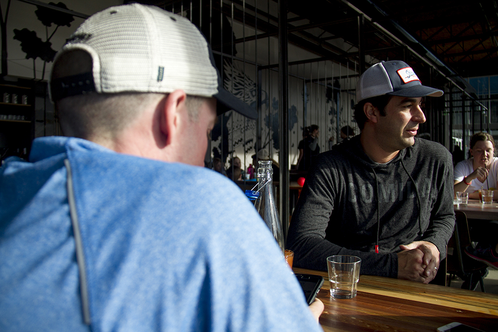 Mark Shaker sits at a table in the Stanley Beer Garden. Stanley Marketplace. Jan 7, 2016. (Kevin J. Beaty/Denverite)  stanley marketplace; aurora; retail; kevinjbeaty; colorado; denverite;