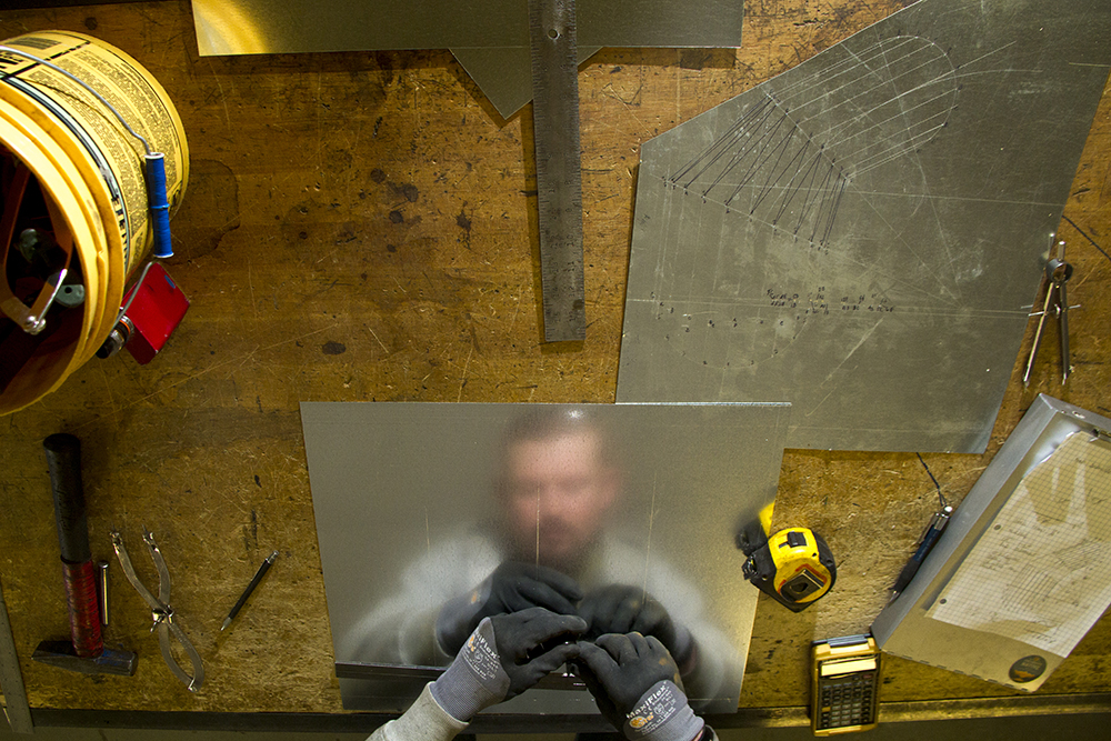 Eric Bouma, a third year apprentice, works on a fitting. Sheet Metal Workers Apprenticeship School of Colorado. Jan. 25, 2017. (Kevin J. Beaty/Denverite)  sheet metal apprentices; apprentices; denver; colorado; denverite; kevinjbeaty;