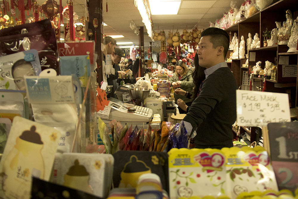 Michael Ye in his shop, Truong An Far East Asian Gifts, at Alameda and Federal. Chinese New Year, Jan. 29. 2017. (Kevin J. Beaty/Denverite)chinese new year; federal boulevard; westwood; denver; kevinjbeaty; denverite; colorado;