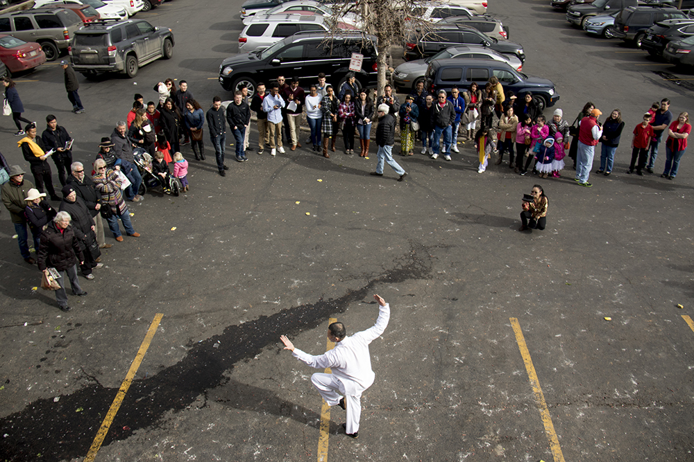Daniel Ha of Tai Kung Ha Tai Chi demonstrates his art in front of Truong An Far East Asian Gifts during Chinese New Year, Jan. 29. 2017. (Kevin J. Beaty/Denverite)  chinese new year; federal boulevard; westwood; denver; kevinjbeaty; denverite; colorado;