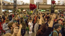 Protests at DIA, Jan. 28, 2017. (Kevin J. Beaty/Denverite)  amal kassir; immigration; refugees; politics; protest; copolitics; rally; dia; denver; colorado; kevinjbeaty;