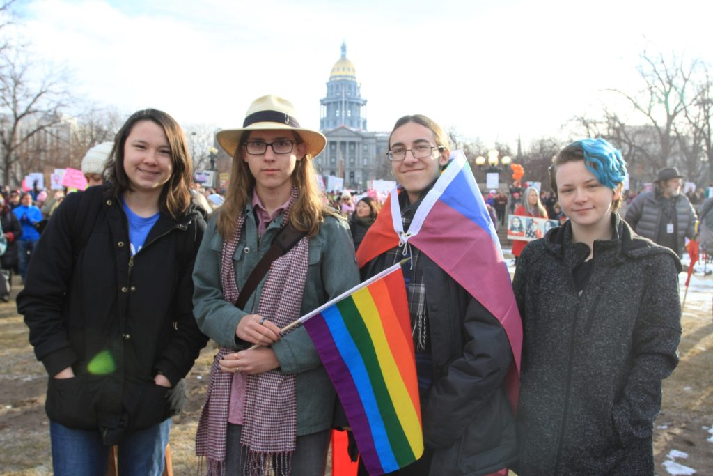 Standley Lake High School students (left to right) Makena Howard, Egan Walker, L.T. Cheatham and Breauna (last name declined) attend the Women's March on Denver on Saturday, Jan. 21, 2017.