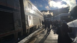 Passengers unload from the Winter Park Express on Jan. 7 at Winter Park. (Andrew Kenney/Denverite)