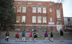 Students at University Prep, a Denver charter school, enter the building in 2013. (Photo: Marc Piscotty)
