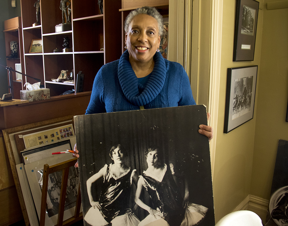 Terri Gentry shows a photo of her twin, performing grandmother and great aunt, Ernestine and  and Josephine McClain, godchildren of Dr. Joseph H.P. Westbrook. The Black American West Museum. (Kevin J. Beaty/Denverite)  black american west museum; history; five points; kevinjbeaty; denverite; denver; colorado
