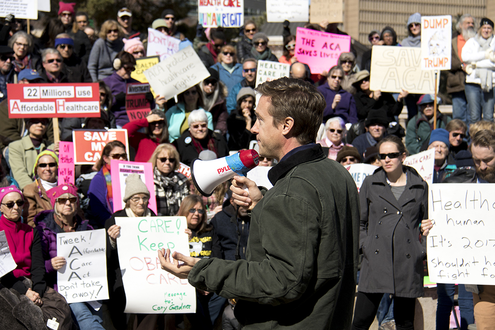 Gubernatorial candidate Mike Johnston speaks at a rally in support of the Affordable Care Act, Feb. 25, 2017. (Kevin J. Beaty/Denverite)  affordable care act; healthcare; aca; copolitics; rally; protest; civic center park; kevinjbeaty; denver; denverite; colorado;