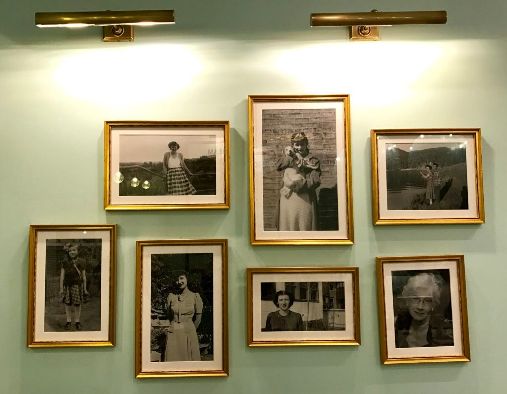 Photos of owner Paul Tamburello's mother, who was nicknamed Cooie, hang on the wall inside Sweet Cooie's, 3506 E. 12th Ave. (Ashley Dean/Denverite)