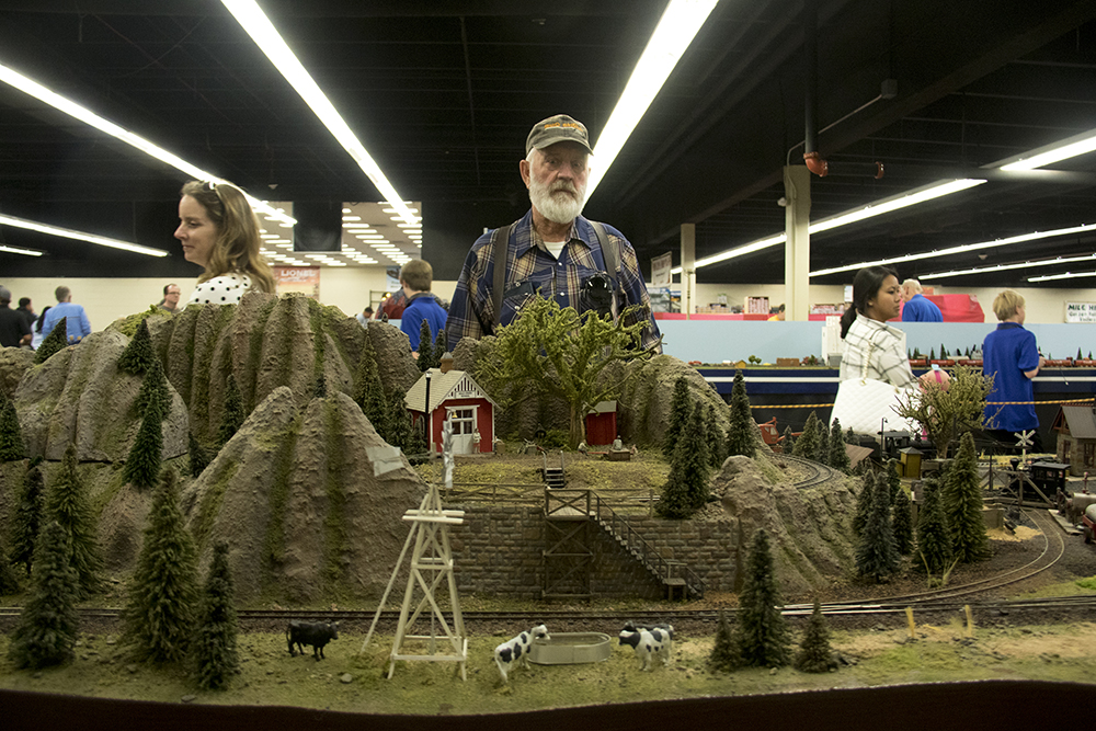 Kendra Terrill and Gary Martin watch the trains. The Rocky Mountain Toy Train Show, Mar. 4, 2017. (Kevin J. Beaty/Denverite)  hobby; toy train; model train; toys; kevinjbeaty; denver mart; rocky mountain toy train show; colorado; denver; denverite;