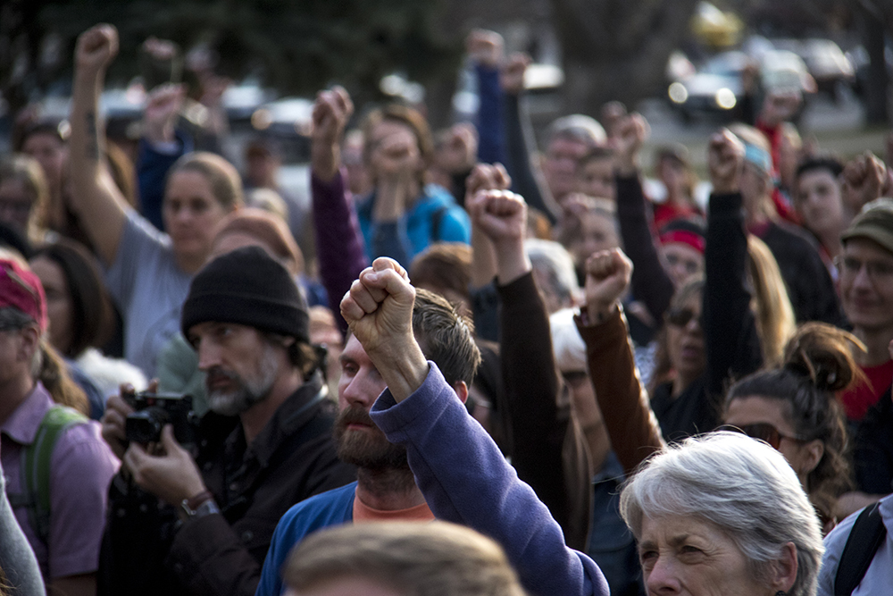 Ralliers raise fists in the air. A rally against the Dakota Access Pipeline, March 10, 2017. (Kevin J. Beaty/Denverite)  march; protest; rally; sunken gardens; capitol; indigenous; native american; nodapl; dakota access pipeline; standing rock; kevinjbeaty; denver; denverite; colorado;
