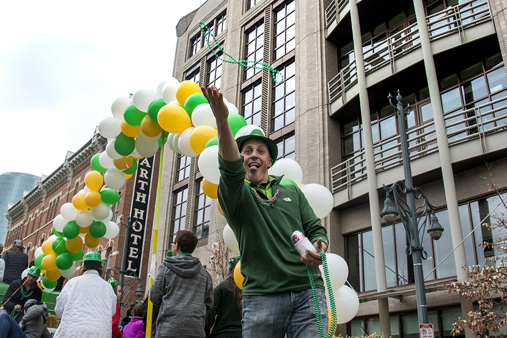 Jared Cummings on the Duffy Crane and Hauling float. St. Patrick's Day celebration, March 11, 2017. (Kevin J. Beaty/Denverite)st. patricks day; union station; kevinjbeaty; denver; colorado; denverite;