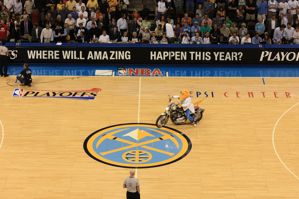 Denver Nuggets mascot Rocky rides a motorcycle on the basketball court, which is not allowed during regulation play. (Flickr/David Herrera)