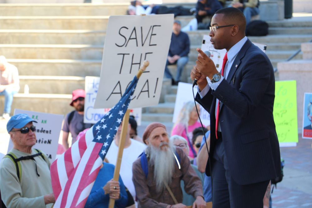 Tay Anderson addresses the crowd during a rally to demand an investigation into Donald Trump's connections to Russia at Civic Center Park. March 18, 2017. (Ashley Dean/Denverite)