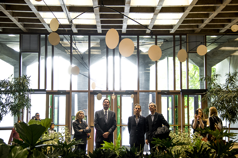 "Tara Bardeen of Go Play Denver (left to right), Denver Botanic Gardens' CEO Brian Vogt, Calder's grandson Sandy Rower and Curator Alfred Pacquement gaze at ""Snow Flurry,"" the exhibit's only indoor sculpture. The opening of a show of Alexander Calder's work at the Denver Botanic Gardens, April 28, 2017. (Kevin J. Beaty/Denverite)  denver botanic gardens; alexander calder; art; sculpture; kevinjbeaty; museum; denver; denverite; colorado;"