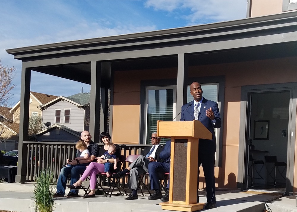 Councilperson Christopher Herndon speaking in front of a Stapleton home. (Megan Arellano/Denverite)