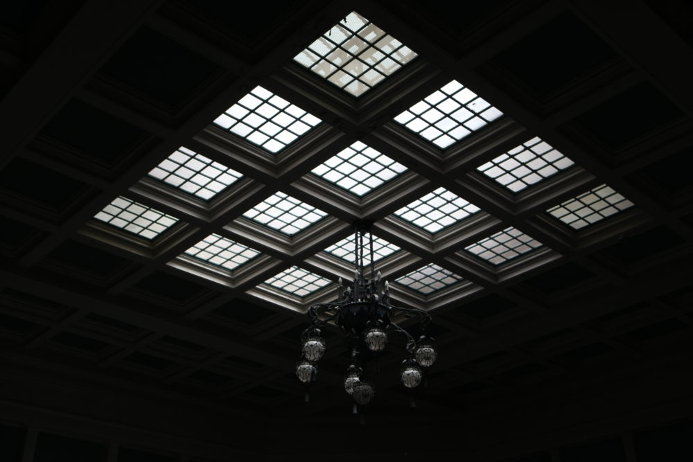 The skylights and chandelier of the Althea Center. (Andrew Kenney/Denverite)