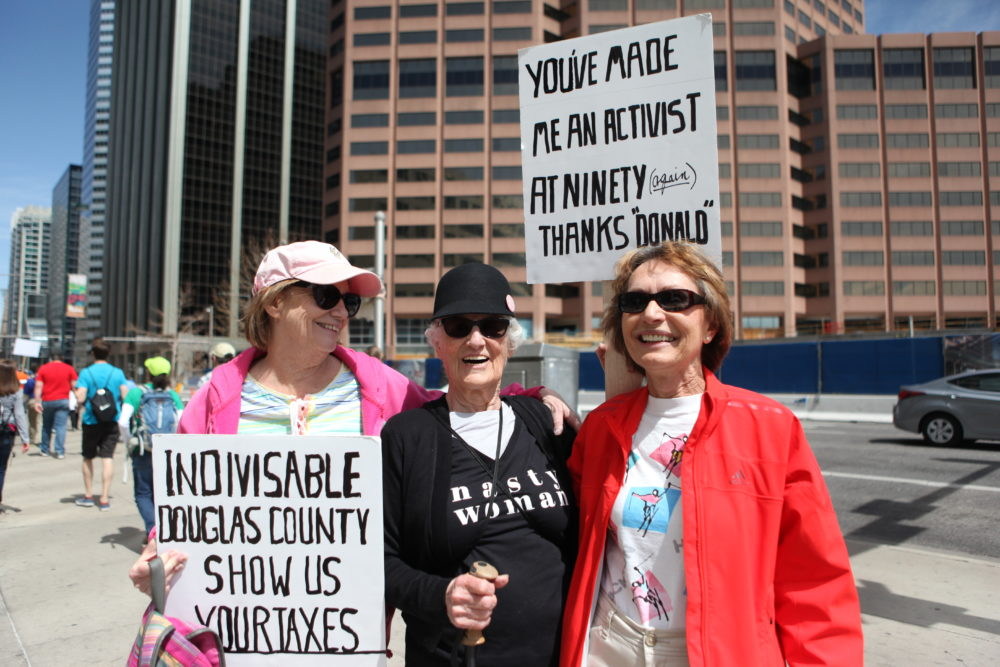 Sally Simmons, Mary Butler and Brigitte Parker at the Tax Day march. (Andrew Kenney/Denverite)
