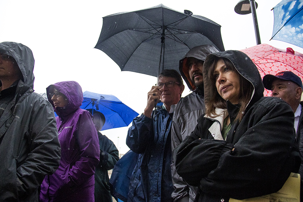 Arturo Hernandez Garcia and his wife, Ana, stand under light rain at a rally for Ingrid Encalada Latorre outside the Jefferson County courthouse, May 3, 2017. (Kevin J. Beaty/Denverite)  immigration; undocumented; deportation; law; court; jefferson county; golden; colorado; kevinjbeaty