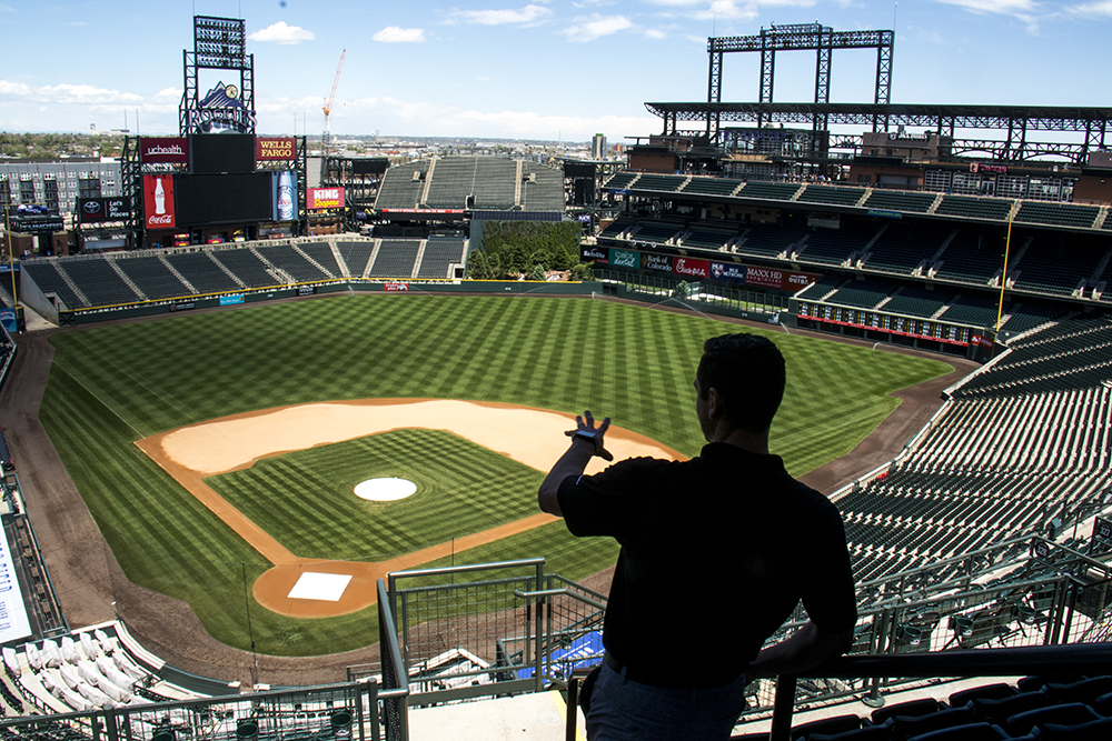 The Colorado Rockies' assistant director of digital media and publications, Julian Valentin, looks out over Coors Field, May 17, 2017. (Kevin J. Beaty/Denverite)  colorado rockies; coors field; kevinjbeaty; denver; denverite; colorado;