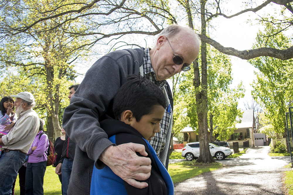 David Poundstone, a member of both the Mountain Friends Meeting and the Denver Metro Sanctuary Coalition, hugs Ingrid Encalada Latorre's son Bryant after she left sanctuary, May 20, 2017. (Kevin J. Beaty/Denverite)  immigration; ingrid encalada latorre; deportation; undocumented; sanctuary; kevinjbeaty; denver; denverite; colorado;