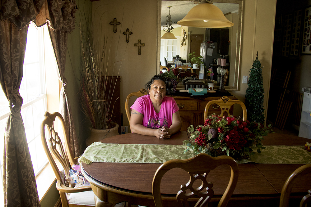 Ana Tovar at her dining room table. Denver Meadows RV Park, May 15, 2017. (Kevin J. Beaty/Denverite)  aurora; denver meadows; mobile home park; kevinjbeaty; denverite; colorado